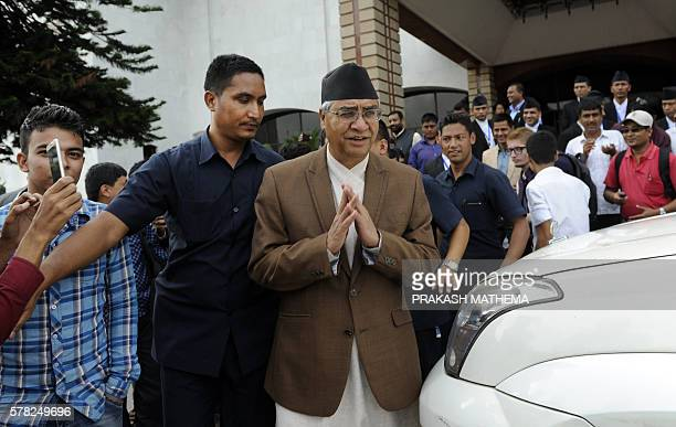 Nepali Congress president Sher Bahadur Deuba leaves the Parliament Building in Kathmandu on July 21 2016 Nepali opposition lawmakers filed a...