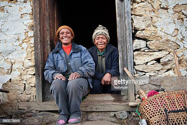 nepali couple in front of their house - village stock pictures, royalty-free photos & images