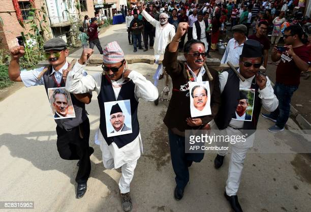 Nepali devotees wear around their necks pictures of Nepalese prime minester Sher Bahadur Deuba Maoist Leader exPrime minister Pushpa Kamal Dahal...