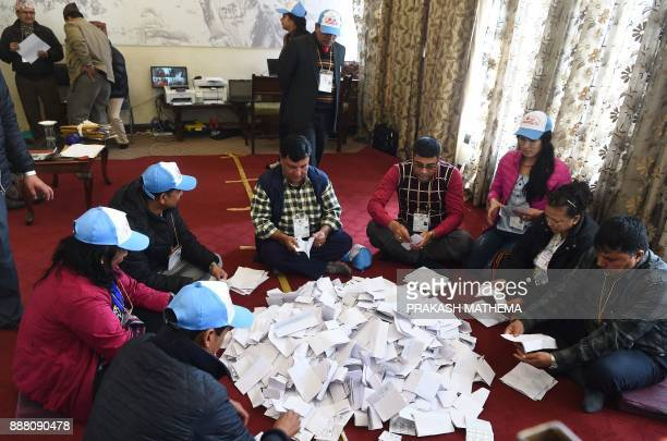 Nepali election commision officials rearrange the ballot papers in Kathmandu on December 8 2017 Nepal has just concluded historic parliamentary...