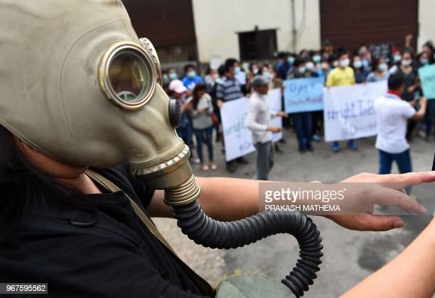 Nepali environmental activist takes part in a rally demanding clean air and dust free roads during a protest marking the 'World Environment Day' in...