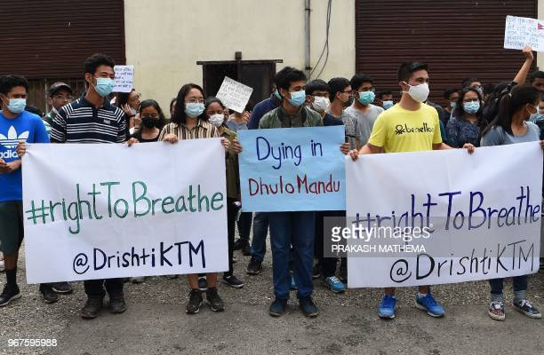 Nepali environmental activists take part in a rally demanding clean air and dust free roads during a protest marking the 'World Environment Day' in...