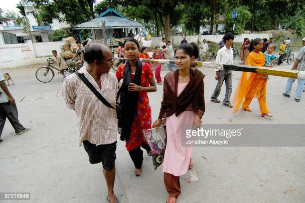 Nepali girl who was about to cross into India is stopped by A Maiti worker October 21 2005 in Kakarbhitta Nepal
