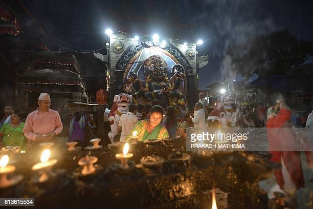 Nepali Hindu devotees pray in front the Hindu God Kaal Bhairav in Durbar Square during the Hindu Festival Dashain in Kathmandu on October 19 2016...
