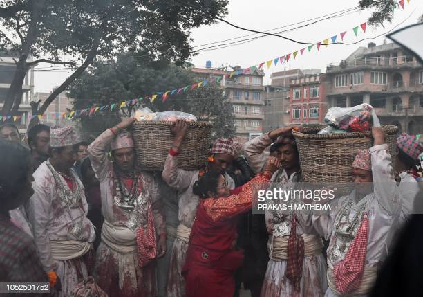 TOPSHOT Nepali Hindu priests carry masks during the tenth day of Dashain in Bhaktapur on the outskirts of Kathmandu on October 19 2018 Dashain is the...