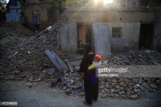 Nepali kid with his mother seen among the debris of buildings in the Bhaktapur city 20km from the capital Kathmandu Nepal on May 5 2015 after the...