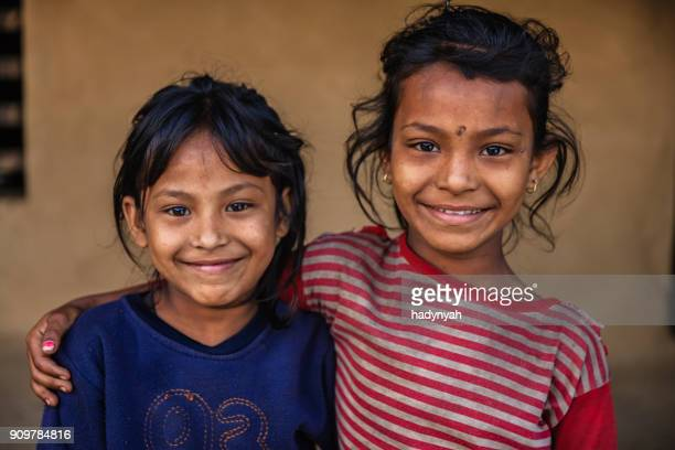 nepali little girls  in village near annapurna range - nepal stock pictures, royalty-free photos & images