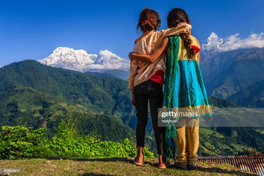 Nepali little girls looking at Annapurna South : Stock Photo