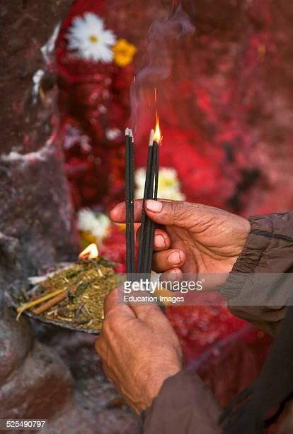 Nepali Man Lights Incense At Bodha Stupa, Kathamandu, Nepal.