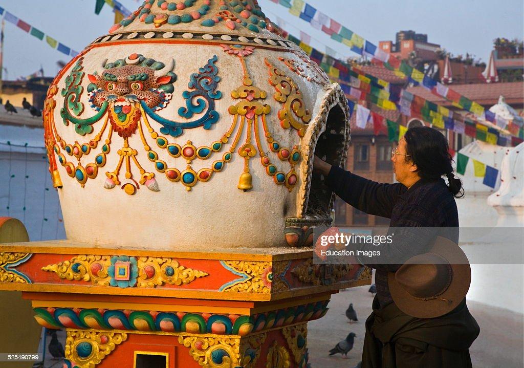 Nepali Man Lights Incense At Bodhanath Stupa In A Burner : News Photo