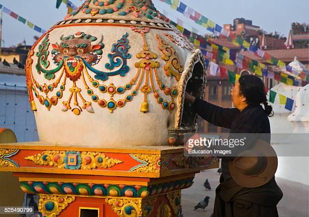 Nepali Man Lights Incense At Bodhanath Stupa In A Burner With Cheppu Guardian Deity Insignias Kathamandu Nepal