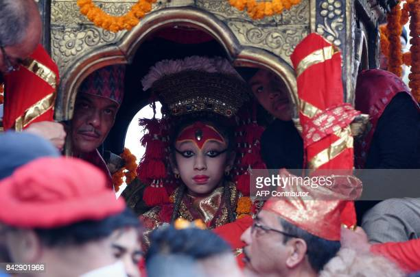 Nepali Matina Shakya revered as a living goddess or Kumari is carried during a procession on the main day of the Indra Jatra festival at Basantapur...