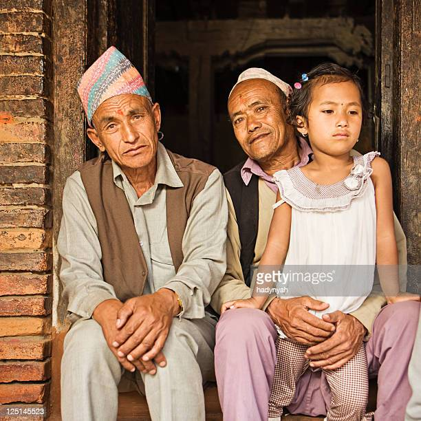 nepali men sitting near durbar square, bhaktapur, nepal - nepalese ethnicity stock pictures, royalty-free photos & images