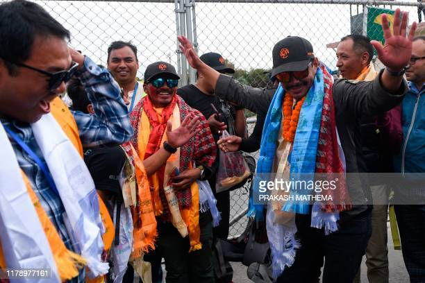 Nepali mountaineer Nirmal Purja dances after arriving at Tribhuvan airport in Nepal's capital Kathmandu on October 30 2019 A Nepali mountaineer on...