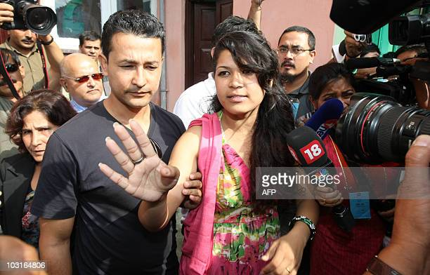 """Nepali Nihita Biswas who reportedly married """"Bikini Killer"""" Charles Sobhraj in prison two years ago, speaks with media outside the Supreme Court in..."""