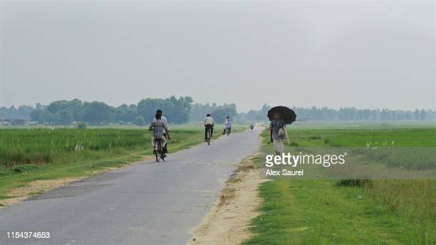 nepali people walking on the road, lumbini area - terai stock pictures, royalty-free photos & images