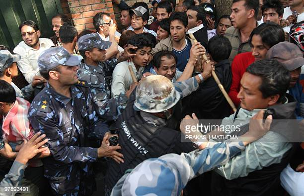 Nepali police attempt to control the crowd trying to enter the viewing hall for the deceased former prime minister and Nepali Congress party...