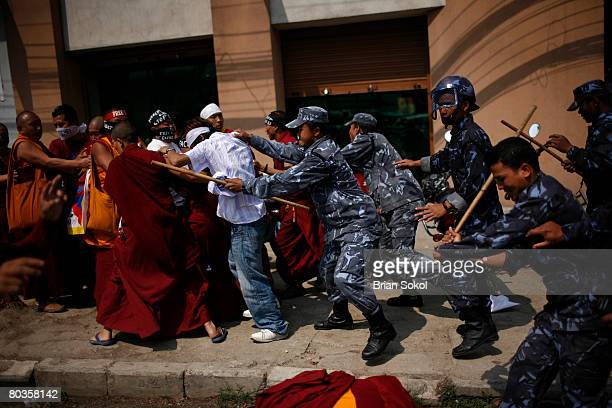 Nepali police baton charge monks nuns and other proTibet demonstrators during a peace protest near the United Nations offices onMarch 24 2008 in...