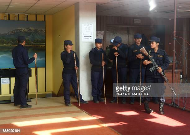 Nepali police stand guard at a vote counting area in Kathmandu on December 8 2017 Nepal has just concluded historic parliamentary elections aimed at...