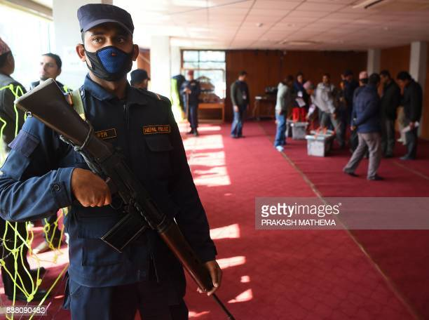 A Nepali police stands guard at a vote counting area in Kathmandu on December 8 2017 Nepal has just concluded historic parliamentary elections aimed...