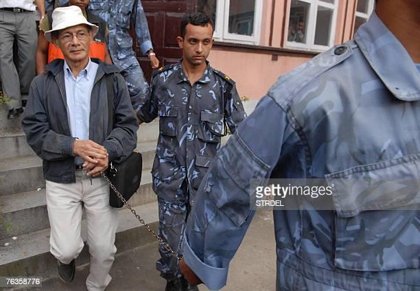 "Nepali policemen preparing to take Charles ""Bikini Killer"" Sobhraj towards Kathmandu Jail after hearing of his appeal on a murder case at the Supreme..."