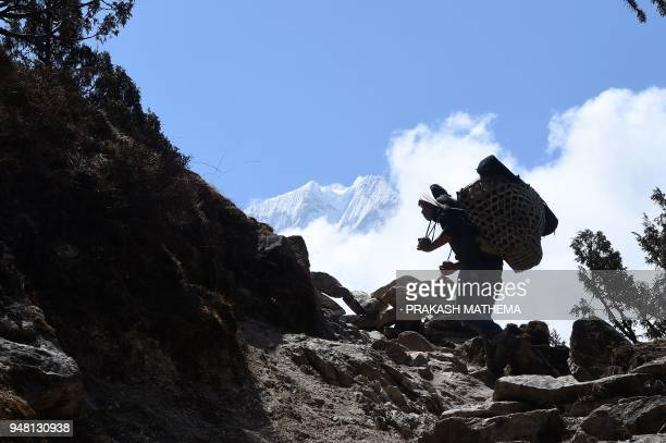 A Nepali porter carries a goods from Phortse village to Pheriche in the Solukhumbu district some 140km northeast of Kathmandu on April 18 2018 The...