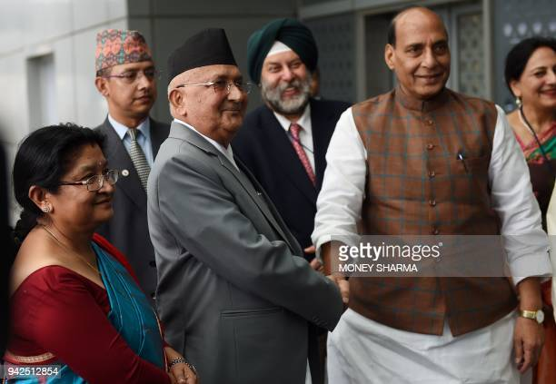 Nepali Prime Minister KP Sharma Oli shakes hands with Indian Home Minister Rajnath Singh upon his arrival at the Indira Gandhi international airport...