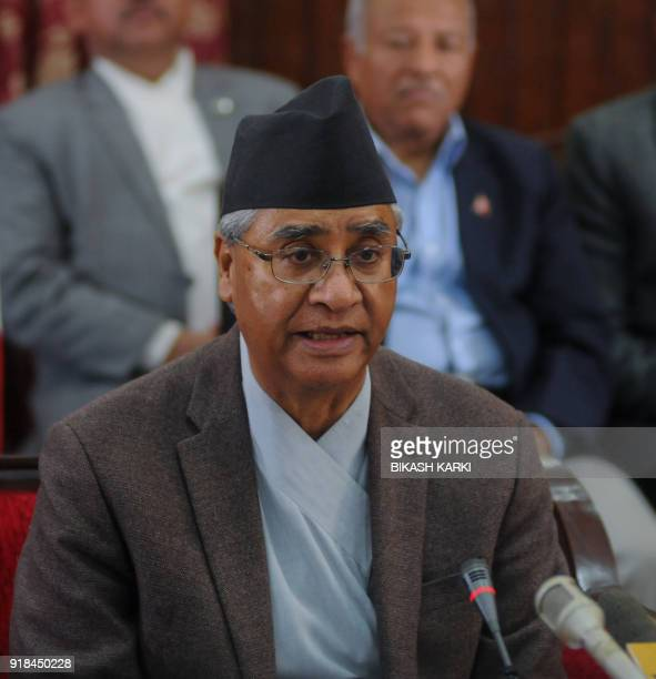 Nepali Prime Minister Sher Bahadur Deuba addresses the nation before submitting his resignation to the president at his official residence in...