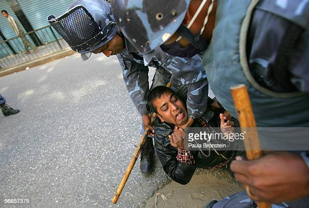 Nepali protester is arrested during a demonstration protesting the rule of King Gyanedra January 24 2006 in Kathmandu Nepal Tensions continue in the...