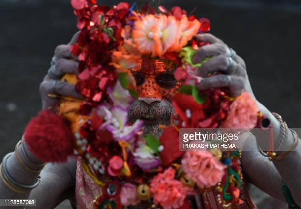 Nepali sadhu poses for a photograph on Maha Shivaratri at the Pashupatinath Temple in Kathmandu on March 4 2019 Hindus mark the Maha Shivaratri...