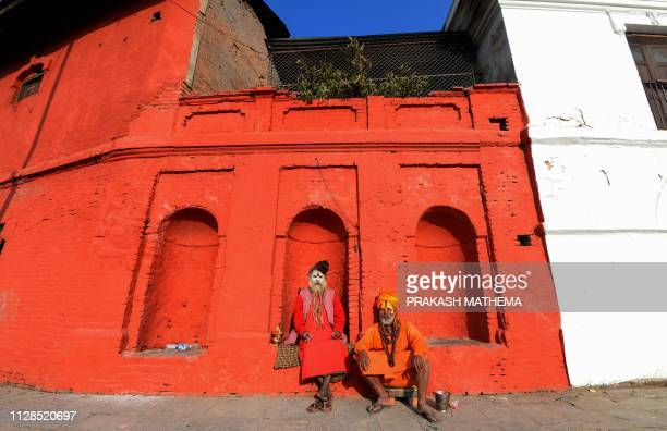 Nepali Sadhus pose for a photograph on the eve of the Hindu festival of Maha Shivaratri at the Pashupatinath Temple in Kathmandu on March 3, 2019. -...