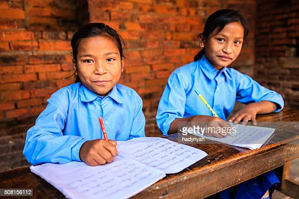 nepali schoolgirls in classroom - nepal stock pictures, royalty-free photos & images