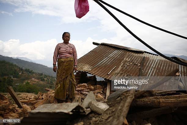 Nepali seen among the debris of destroyed buildings in Sukute district of Bhaktapur, Nepal on April 30, 2015. The death toll in Nepal following the...