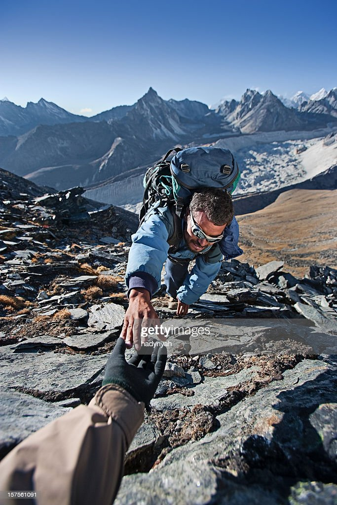 Nepali sherpa climbing in Himalayas : Stock Photo