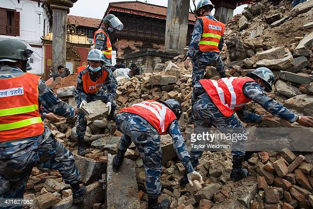 Nepali soldiers and police clear rubble from Durbar Square in Bhaktapur Nepal on April 30 2015 On April 25 Nepal suffered a magnitude 78 earthquake...