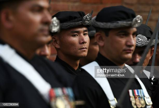 Nepali soldiers dressed in traditional attires take part in the Fulpati procession marking the seventh day of the Dashain festival in Kathmandu on...