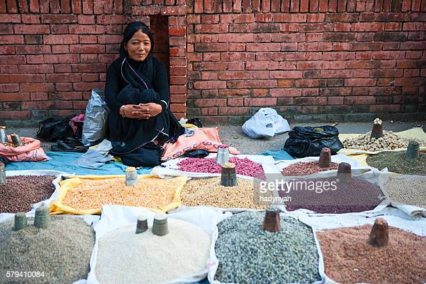 Nepali street seller - selling beans and spices in Kathmandu