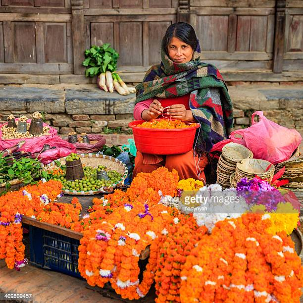nepali street seller selling flowers and vegetables in patan, nepal - neckwear stock pictures, royalty-free photos & images