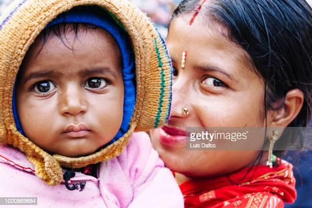 nepali woman and baby child portrait - nepali mother ストックフォトと画像