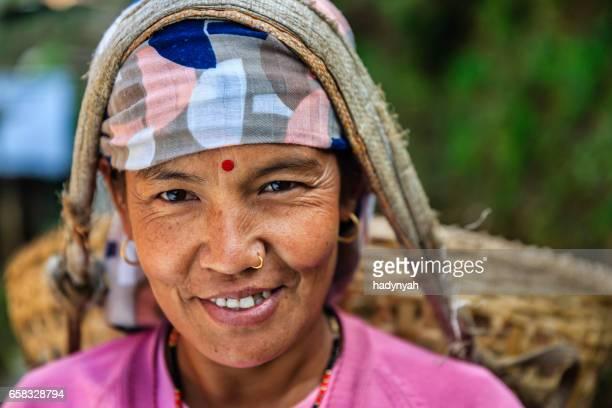 Nepali woman carrying a basket near Annapurna Range
