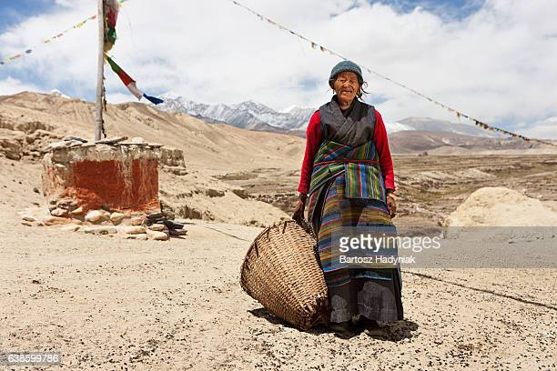 Nepali woman carrying basket in Mustang Region, Nepal
