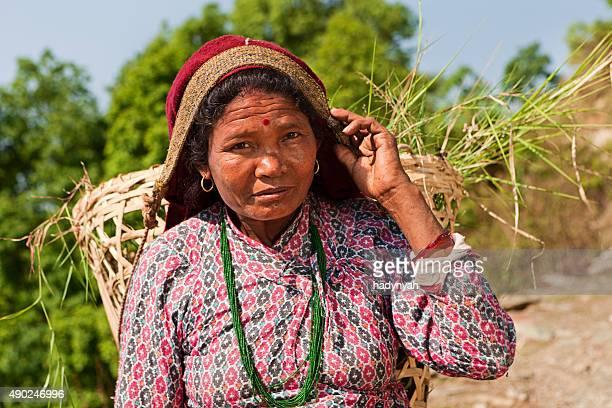 Nepali woman carrying basket near Pokhara