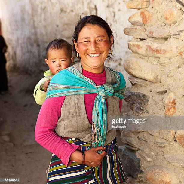 Nepali woman carrying her baby