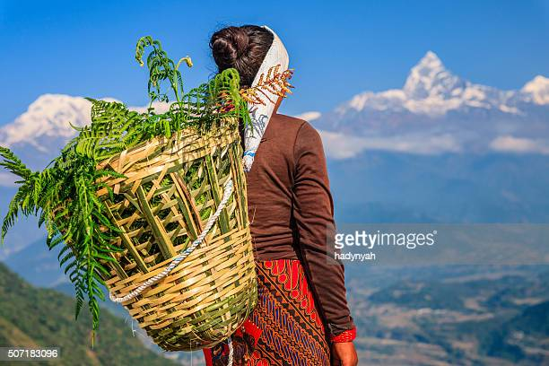 nepali woman looking at machapuchare, pokhara, nepal - nepal stock pictures, royalty-free photos & images