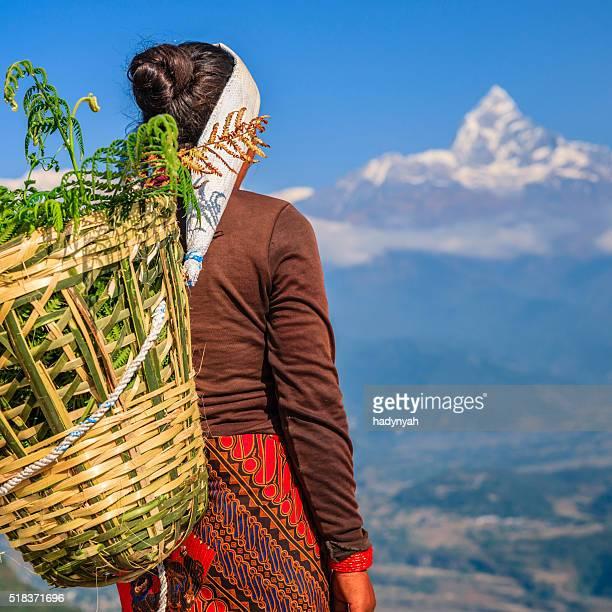 Nepali woman looking at Machapuchare, Pokhara, Nepal