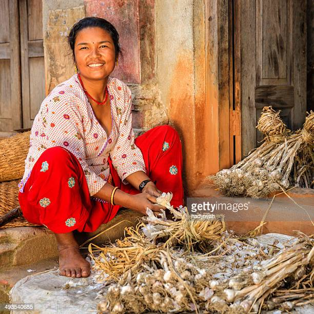 Nepali woman picking over a garlic in Bhaktapur, Nepal