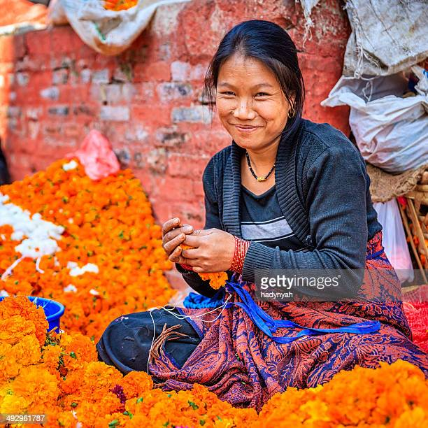 nepali woman selling flowers on durbar square in kathmandu - nepal stock pictures, royalty-free photos & images