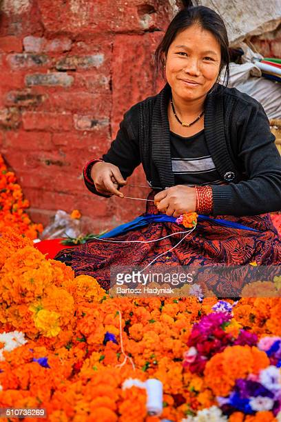 Nepali woman selling flowers on Durbar Square