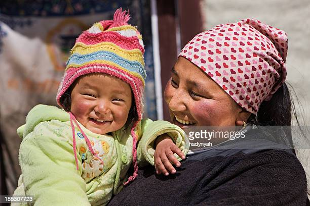 nepali woman with her baby - nepal stock pictures, royalty-free photos & images
