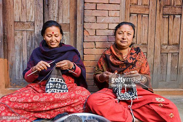 Nepali women  kniting wool hat. Bhaktapur.